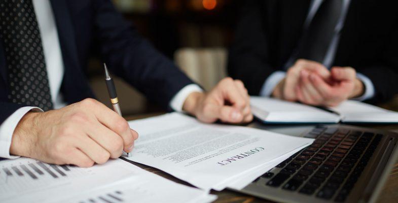 businessman-reading-contract-closeup